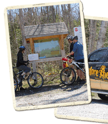 Mountain Bikers viewing Trail Maps